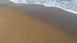 img kensey-beach-sand-outgoing-wave-1.png
